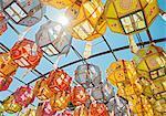 Rows of sunlit lanterns honoring buddhas birthday in Naksansa Temple, Naksansa, Yangyang, Gangwon province, South Korea
