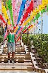 Female tourist pointing at rows of lanterns honoring buddha birthday in Naksansa Temple, Naksansa, Yangyang, Gangwon province, South Korea