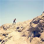 Young boy climbing sandy hill, Hurgada, Red Sea, Egypt