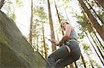 Rock climber scaling rock