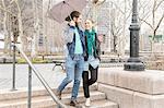 Couple sharing umbrella, New York, New York, USA