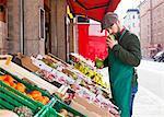 Greengrocer's shop, grocer smelling fruit