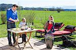 Family having barbecue in garden
