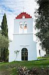Whitewashed Greek Orthodox church at Nimfes (Nymfes), Northern Corfu, Greek Islands, Greece, Europe