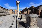 Forum and Vesuvius through arch, Roman ruins of Pompeii, UNESCO World Heritage Site, Campania, Italy, Europe