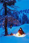 Hunter having fire at dusk