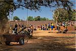 Village people getting water from pump, near Dandougou, Burkina Faso