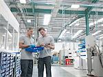 Engineers discussing work in orthopaedic factory