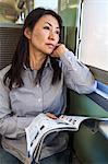 Woman passenger reads on train