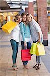 Beautiful women holding shopping bags looking at camera