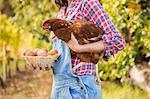 Happy brunette holding her chicken