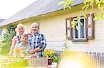 Portrait proud grandparents and grandson selling honey