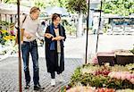 Senior couple shopping at flower market