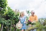 Mature couple shopping in plant nursery, Augsburg, Bavaria, Germany