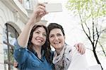 Two friends make selfie in the sidewalk cafe, Bavaria, Germany