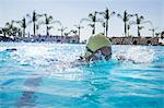 Mature woman swimming in swimming pool, Puglia, Italy