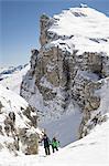 Ski mountaineers climbing on snowy mountain, Val Gardena, Trentino-Alto Adige, Italy