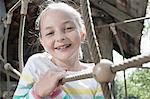 Girl smiling on rope bridge, Munich, Bavaria, Germany