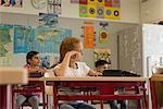 School children dreaming in a classroom, Munich, Bavaria, Germany