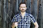 Man holding rake outdoors