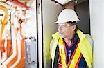 Worker standing in doorway on oil rig