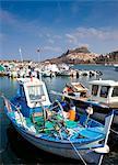 Fishing boats docked in pier