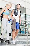 Couple walking on gym steps together
