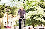Senior man cycling, Hackney Park, London