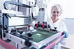 Scientist printing graphene ink test in graphene processing factory