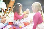 Girls playing picnics at garden birthday party