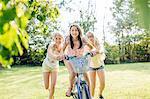 Girls cycling in garden