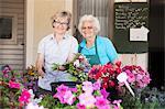 Portrait of female florists among flowers