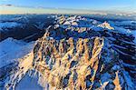 Aerial view of Sassolungo Sassopiatto and Grohmann peaks at sunset, Sella Group, Dolomites, Trentino-Alto Adige, Italy, Europe