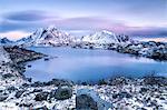 Pinksky dominates the scenery in Reine at dusk, Lofoten Islands, Arctic, Norway, Scandinavia, Europe