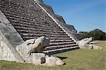 Serpent heads, El Castillo (Pyramid of Kulkulcan), Chichen Itza, UNESCO World Heritage Site, Yucatan, Mexico, North America