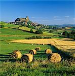 Chateau de Polignac and hay bales, Polignac, Haute-Loire, Auvergne, France, Europe