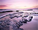 Sunrise over North Sea from Bamburgh beach, Bamburgh, Northumberland, England, United Kingdom, Europe