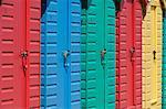 Close-up of multicoloured beach huts on the long sweeping beach of Llanbedrog, Llyn Peninsula, Gwynedd, North Wales, Wales, United Kingdom, Europe