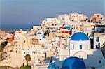 Blue domed churches in the village of Oia, Santorini (Thira), Cyclades Islands, Aegean Sea, Greek Islands, Greece, Europe
