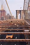 Taxi crossing Brooklyn Bridge, New York City, New York, United States of America, North America