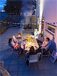 Women sitting at table on backyard