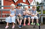 Children on bench having drink