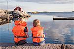 Boys sitting on jetty