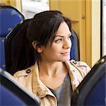 Smiling woman in tram