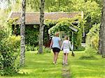Mother with daughter walking in garden