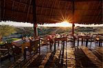 Kenya, Amboseli National Park, Tortilis Camp. Dining tables at sunset.