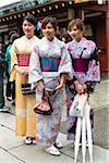 Three Young Women Dressed in Traditional Kimonos at Senso-ji Temple, Asakusa, Tokyo, Japan