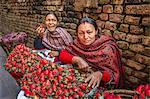 Nepali women selling strawberries on local market