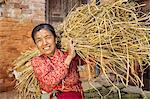 Nepali woman carrying a straw in Bhaktapur