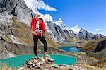 Woman trekking near Tres lagunas in Peruvian Andes